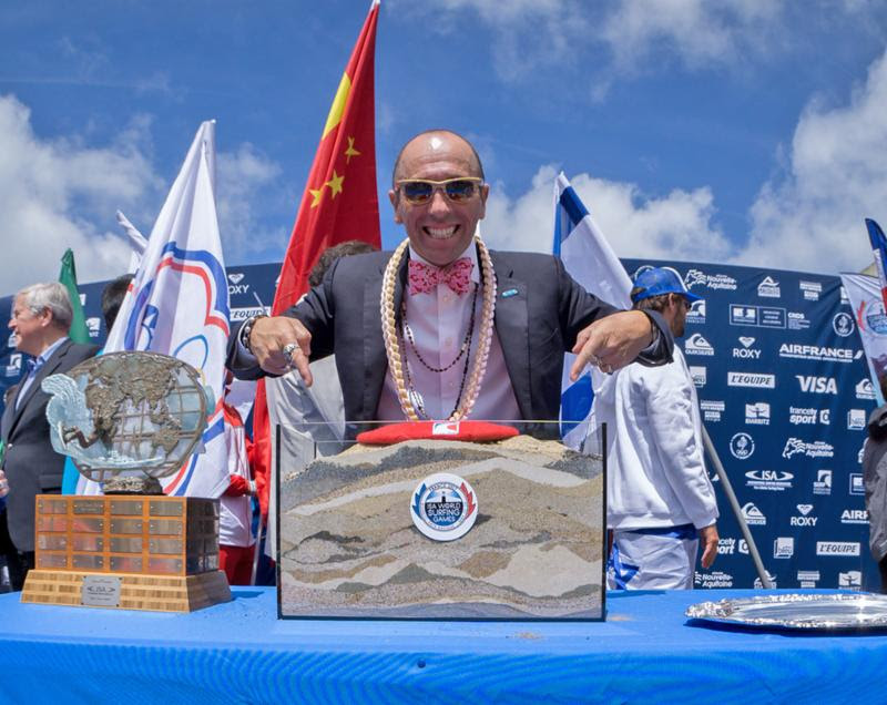 ISA President Fernando Aguerre displays the sand of 47 nations at the 2017 ISA World Surfing Games in Biarritz, France. Photo: ISA /Sean Evans