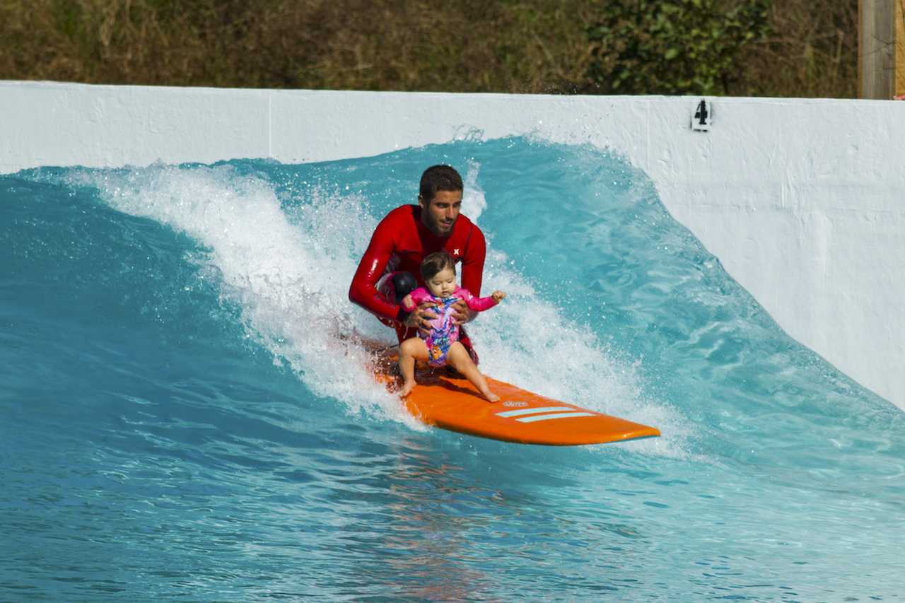 WCT surfer Felipe Toldeo with his daughter at the Wavegarden Cove