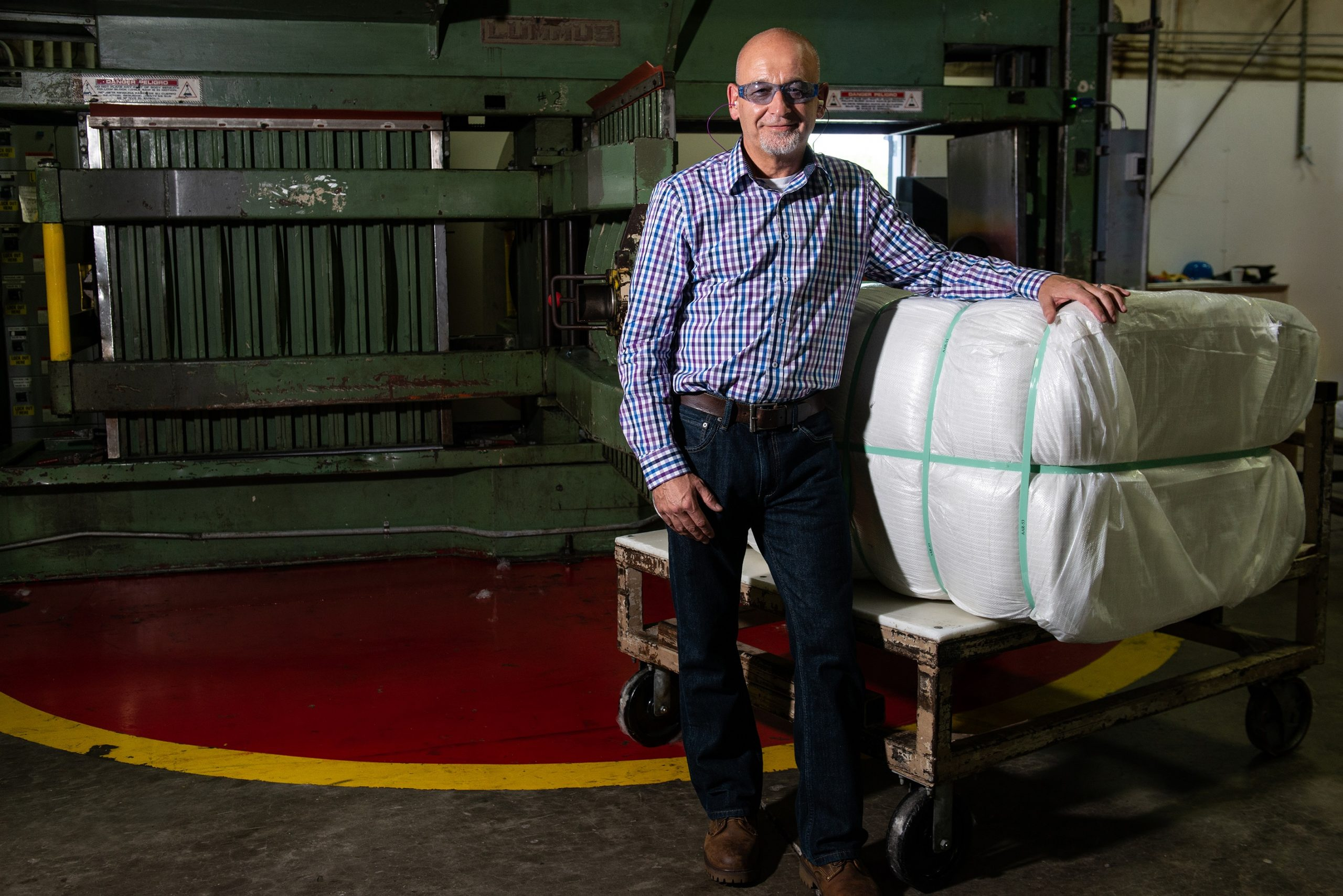 PrimaLoft Product Engineer Robert Dempsey with the first bale of fine denier high performance PrimaLoft biodegradable fibre