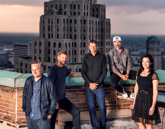 From left: D/CAL co-founders Ryan Maconochie, Jared Prindle, Tony Hawk and Adam Wilson with Katherine Huber, director of client services, atop the Guardian Building in downtown Detroit, where they have an office for their new agency.