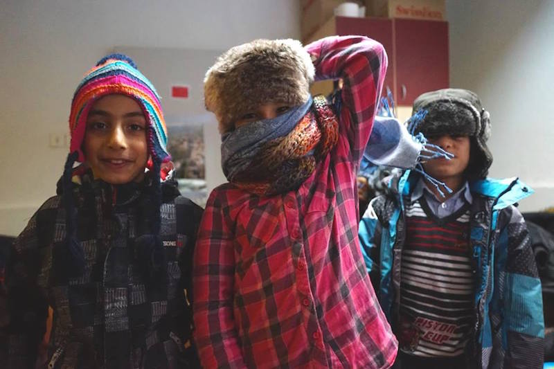 Riders for Refugees_refugee children in their warm clothing_by Alexis de Tarade