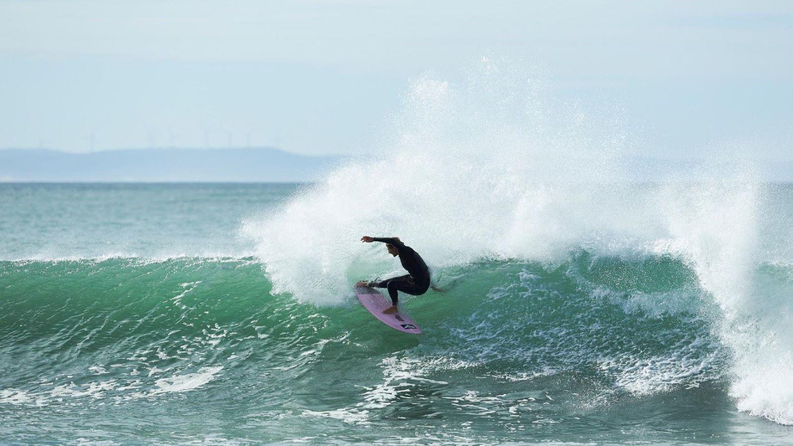 Stephanie Gilmore hitting the waves